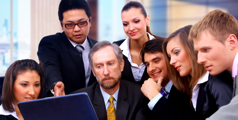 Business team watching Observic video on laptop